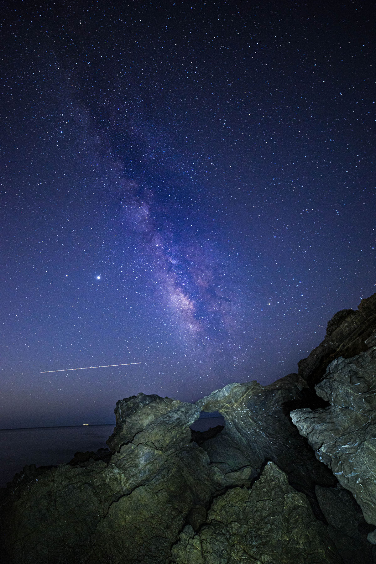 photo of the sky at night stars, rock